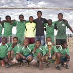 Abiel with his soccer team in Bophelong