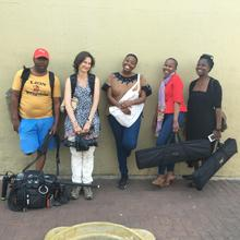 The I Am Woman crew with Phindile, holding up a building during her shoot