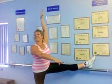 Lynne at her wall of certificates