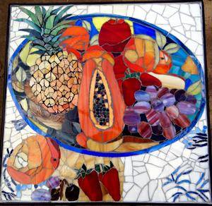 Glass mosaic fruit bowl on wrought iron table. SOLD for R3000