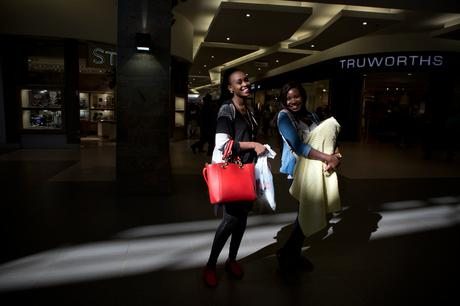 thumbnail for Sisters Lindiwe Mwanza, 25, and Mainza Mwanza, 28, with her new baby, in Levy Mall Shopping Center.