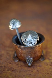 A little silver mushroom in a bronze pot