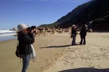 Izette Mostert, episode director, takes stills while Lisa and Alix chat on Noetzie Beach