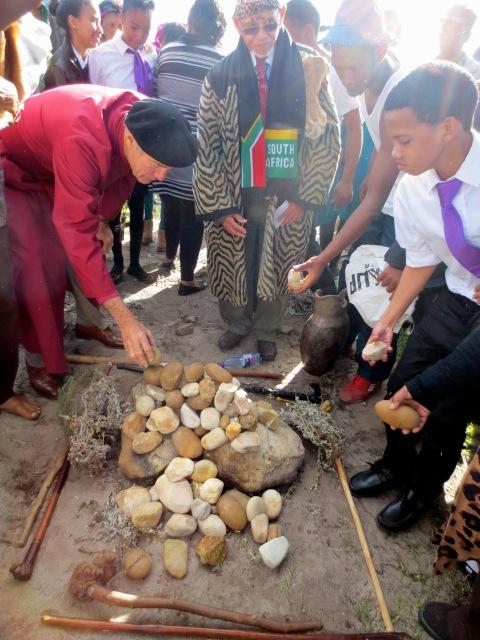 Bishop Geoff Davies and Chief Hennie van Wyk add stones to the cairn