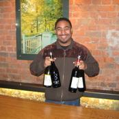 Here's Roland at Rustenburg winery, with his hands full!