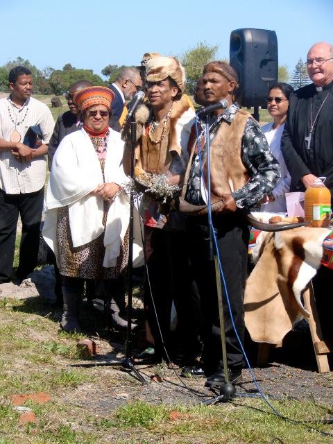 Bradley van Sitters, does opening prayer in Nama. Left: Mary Jansen