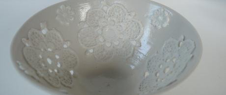 1.11 White porcelain bowl with lace cut outs.
