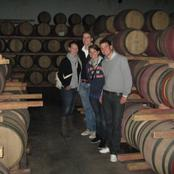 Dutchies surrounded by Barrels of wine.