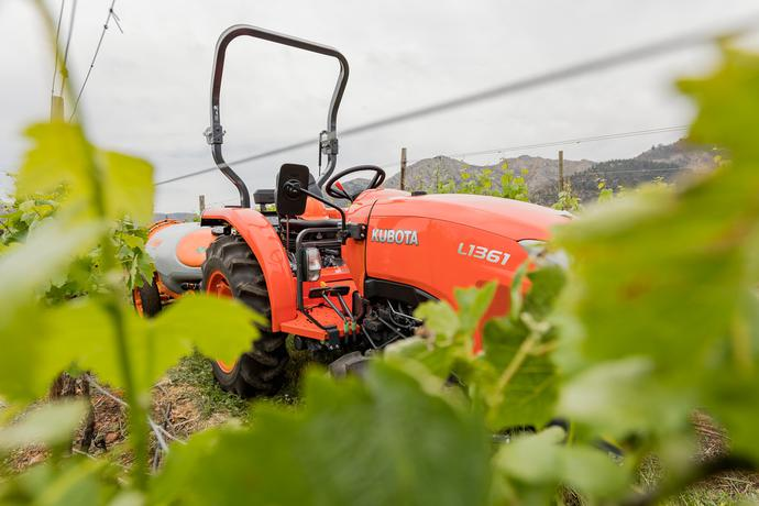 Advertising images of the Kubota L1361DW, Kubota L1421DW and Kubota L1421DHW in Agriculture.