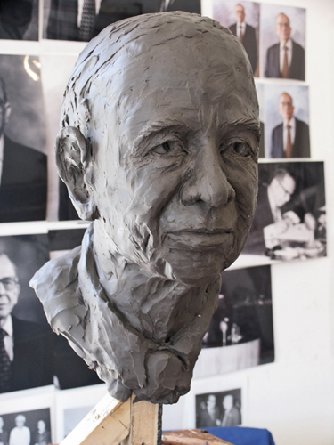 Portrait in early stages of clay