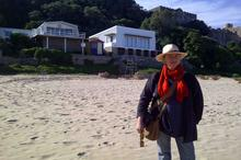 Alix on Noetzie Beach in front of the house (back left) where she was attacked