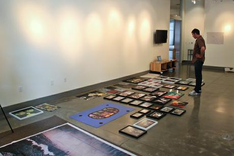Determining what to hang where... with the help of curator Logan McClain.