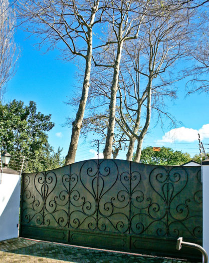 Sliding driveway gate with forged decorative detail