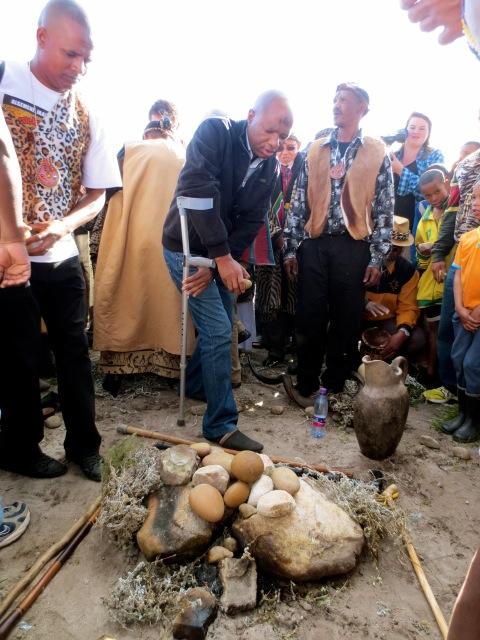 Chief Mandla Ngonyama of the Abathembu Tribe adds a stone