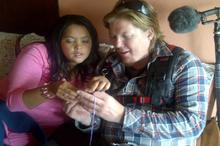 Esme teaches soundman Henau Marais how to crochet