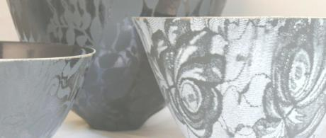1.19 Black and black and white earthenware bowls with lace glaze.