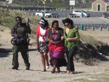 Marylin & Lisa take a stroll on Strandfontein Beach, cameras rolling