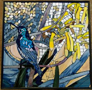 Sunbird & Alo glass mosaic on wrought iron table.   SOLD for R3000