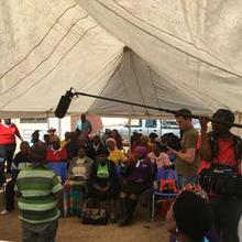 Filming at one of the FEDUP women's savings gatherings